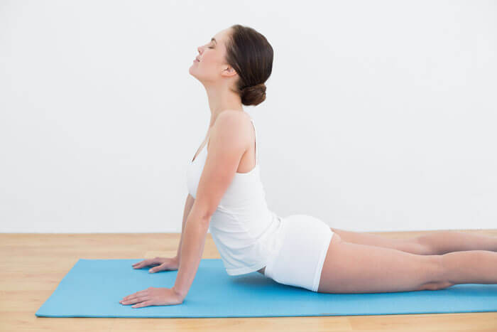 Woman stretching her back